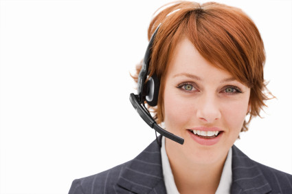 Closeup portrait of a happy young businesswoman with headset isolated over white background